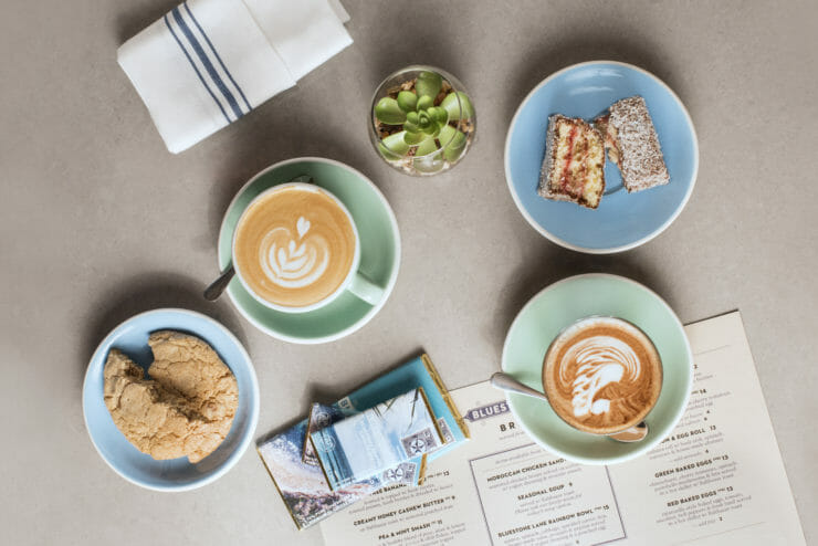 aerial view of a table top with lattes, and pastries.