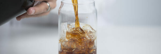 Cold Brew being poured into a glass.