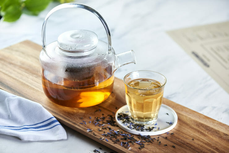 tea pot and glass cup filled with tea.