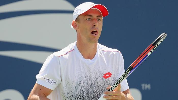 John Millman Holding Tennis racket mid-play